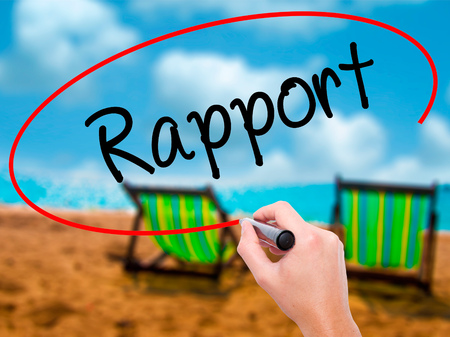 rapport: Man Hand writing Rapport with black marker on visual screen. Isolated on sunbed on the beach. Business, technology, internet concept. Stock Photo Stock Photo