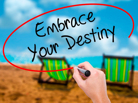 leadership potential: Man Hand writing Embrace Your Destiny with black marker on visual screen. Isolated on sunbed on the beach. Business, technology, internet concept. Stock  Photo