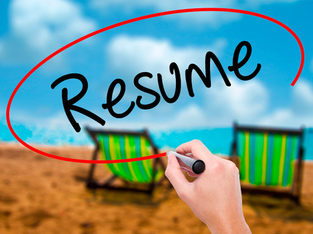 Man Hand writing Resume with black marker on visual screen. Isolated on sunbed on the beach. Business, technology, internet concept. Stock Photo