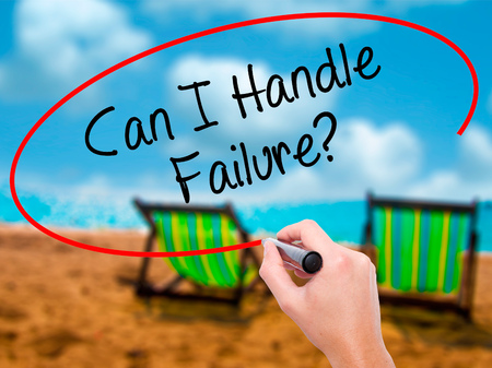 Man Hand writing Can I Handle Failure? with black marker on visual screen. Isolated on sunbed on the beach. Business, technology, internet concept. Stock Photo Stock Photo
