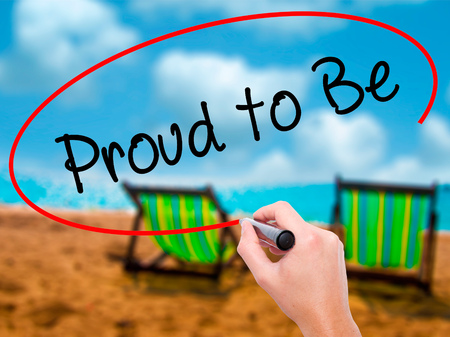 first nations: Man Hand writing Proud to Be with black marker on visual screen. Isolated on sunbed on the beach. Business, technology, internet concept. Stock Photo Stock Photo