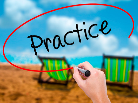 make belief: Man Hand writing Practice with black marker on visual screen. Isolated on sunbed on the beach. Business, technology, internet concept. Stock Photo