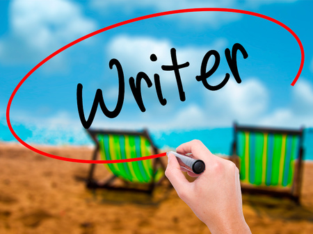 Man Hand writing Writer with black marker on visual screen. Isolated on sunbed on the beach. Business, technology, internet concept. Stock Photo Stock Photo