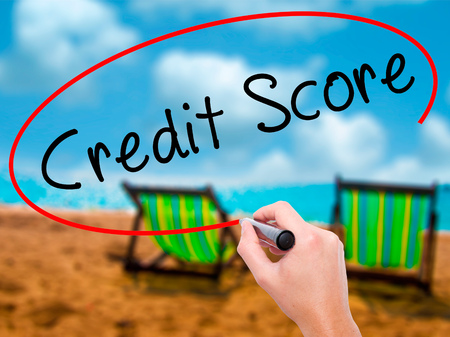 Man Hand writing Credit Score black marker on visual screen. Isolated on sunbed on the beach. Business, technology, internet concept. Stock Image