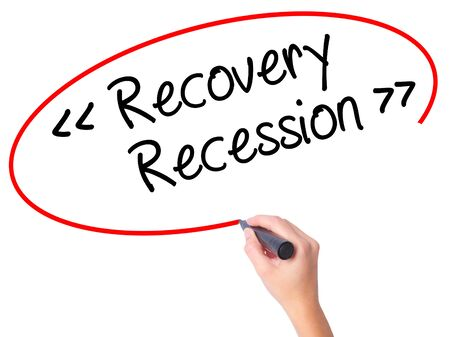 Women Hand writing  Recovery - Recession with black marker on visual screen. Isolated on white. Business, technology, internet concept. Stock Photo Stock Photo