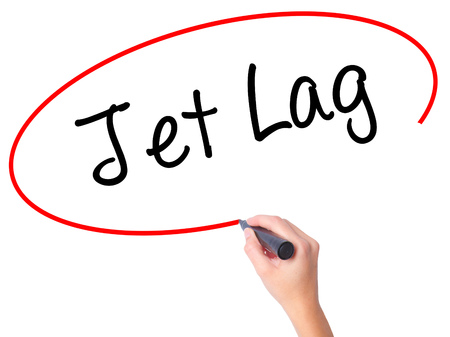 Women Hand writing  Jet Lag with black marker on visual screen. Isolated on white. Business, technology, internet concept. Stock Photo