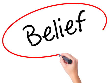 beliefs: Women Hand writing Belief with black marker on visual screen. Isolated on white. Business, technology, internet concept. Stock Photo