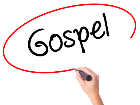 credo: Women Hand writing Gospel  with black marker on visual screen. Isolated on white. Business, technology, internet concept. Stock Photo