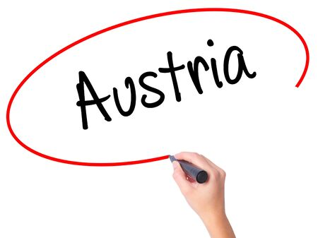 Women Hand writing  Austria with black marker on visual screen. Isolated on white. Business, technology, internet concept. Stock Photo