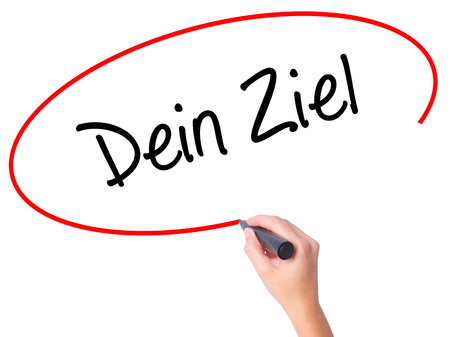 Women Hand writing Dein Ziel (Your Goal in German)  with black marker on visual screen. Isolated on white. Business, technology, internet concept. Stock Photo