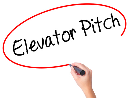 business pitch: Women Hand writing Elevator Pitch with black marker on visual screen. Isolated on white. Business, technology, internet concept. Stock Photo