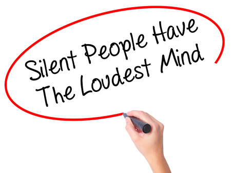 loudest: Women Hand writing Silent People Have The Loudest Mind with black marker on visual screen. Isolated on white. Business, technology, internet concept. Stock Photo