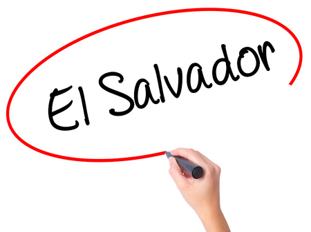 Women Hand writing El Salvador with black marker on visual screen. Isolated on white. Business, technology, internet concept. Stock Photo