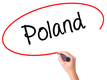 Women Hand writing Poland  with black marker on visual screen. Isolated on white. Business, technology, internet concept. Stock Photo