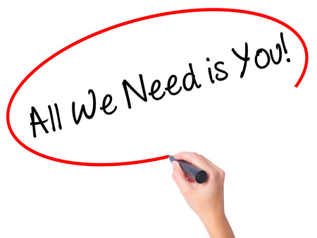 Le donne scrivono a mano All We Need is You! con pennarello nero su schermo visivo. Isolato su bianco Affari, tecnologia, concetto di internet. Foto d'archivio