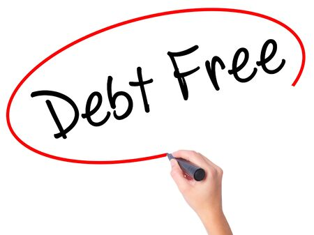 Women Hand writing Debt Free with black marker on visual screen. Isolated on white. Business, technology, internet concept. Stock Photo