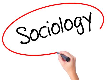 sociology: Mujeres mano escribiendo Sociología con marcador negro en la pantalla visual. Aislado en blanco. Negocios, la tecnología, el concepto de internet. Foto de stock