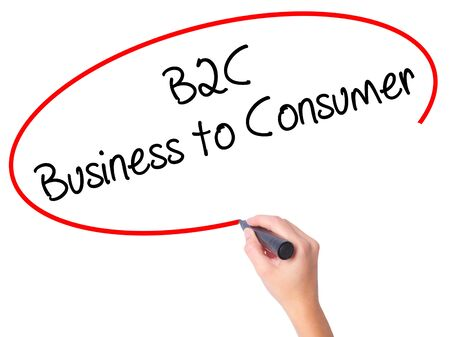 Women Hand writing B2C Business to Consumer with black marker on visual screen. Isolated on white. Business, technology, internet concept. Stock Photo
