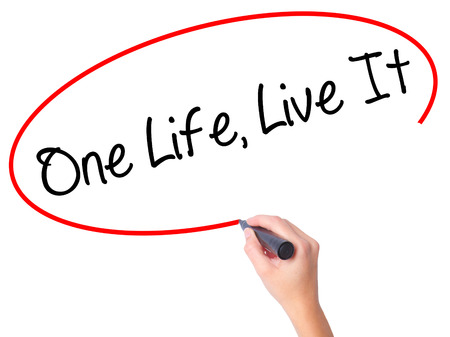 adrenaline rush: Women Hand writing One Life Live It with black marker on visual screen. Isolated on white. Business, technology, internet concept. Stock Photo Stock Photo