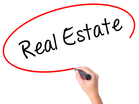 finer: Women Hand writing Real Estate  with black marker on visual screen. Isolated on white. Business, technology, internet concept. Stock Photo