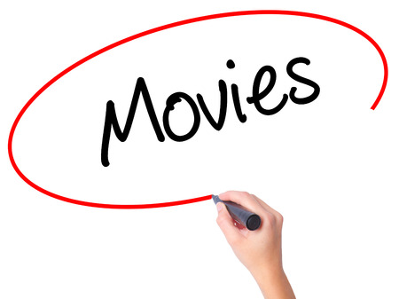 Women Hand writing  Movies with black marker on visual screen. Isolated on white. Business, technology, internet concept. Stock Photo Stock Photo