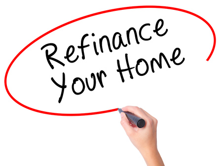 Women Hand writing Refinance Your Home with black marker on visual screen. Isolated on white. Business, technology, internet concept. Stock Image