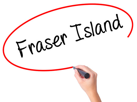 Women Hand writing Fraser Island with black marker on visual screen. Isolated on white. Business, technology, internet concept. Stock  Photo Stock Photo