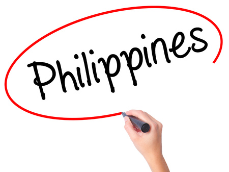 Women Hand writing Philippines with black marker on visual screen. Isolated on white. Business, technology, internet concept. Stock Photo