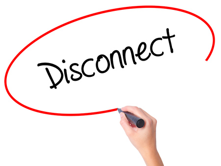 disconnection: Women Hand writing Disconnect with black marker on visual screen. Isolated on white. Business, technology, internet concept. Stock Photo
