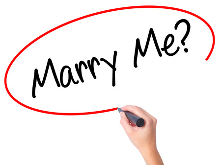 Women Hand writing Marry Me? with black marker on visual screen. Isolated on white. Business, technology, internet concept. Stock  Photo