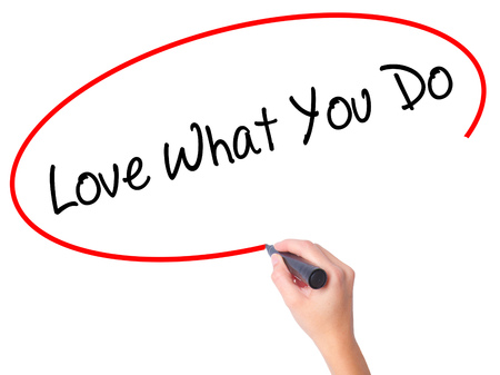 Women Hand writing Love What You Do with black marker on visual screen. Isolated on white. Business, technology, internet concept. Stock Photo