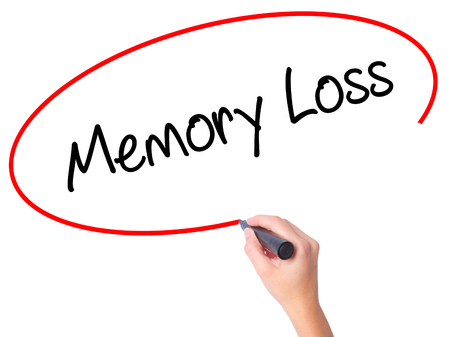 aging brain: Women Hand writing Memory Loss with black marker on visual screen. Isolated on white. Business, technology, internet concept. Stock Photo