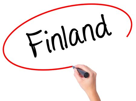 Women Hand writing Finland with black marker on visual screen. Isolated on white. Business, technology, internet concept. Stock  Photo Stock Photo