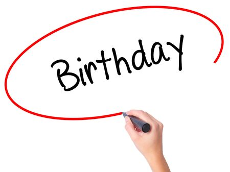 Women Hand writing Birthday with black marker on visual screen. Isolated on white. Business, technology, internet concept. Stock Photo