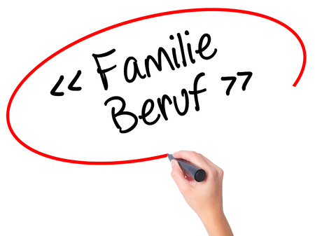 Women Hand writing familie beruf (Family Occupation in German) with black marker on visual screen. Isolated on white. Business, technology, internet concept. Stock Photo