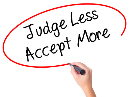 unfavorable: Women Hand writing Judge Less Accept More with black marker on visual screen. Isolated on white. Business, technology, internet concept. Stock Photo
