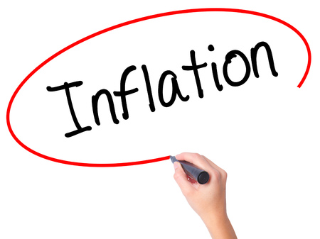 economic theory: Women Hand writing Inflation with black marker on visual screen. Isolated on white. Business, technology, internet concept. Stock Photo