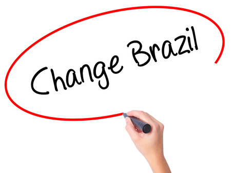 Women Hand writing Change Brazil  with black marker on visual screen. Isolated on white. Business, technology, internet concept. Stock Photo Stock Photo