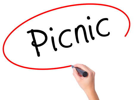picknick: Women Hand writing Picnic with black marker on visual screen. Isolated on white. Business, technology, internet concept. Stock Photo Stock Photo