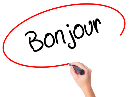 Women Hand writing Bonjour  (Good Morning in French) with black marker on visual screen. Isolated on white. Business, technology, internet concept. Stock Photo