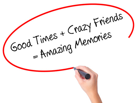 positiveness: Women Hand writing Good Times + Crazy Friends = Amazing Memories with black marker on visual screen. Isolated on white. Business, technology, internet concept. Stock Photo