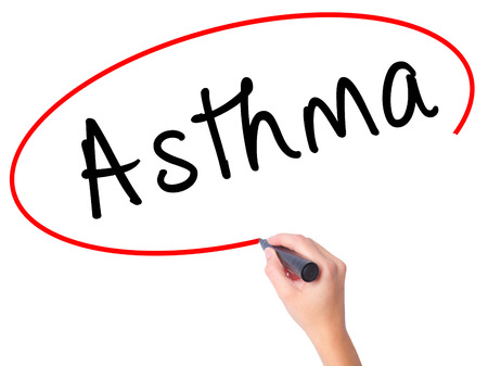 Women Hand writing Asthma with black marker on visual screen. Isolated on white. Business, technology, internet concept. Stock Image