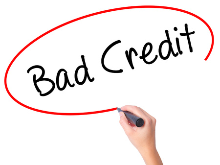 budget repair: Women Hand writing Bad Credit with black marker on visual screen. Isolated on white. Business, technology, internet concept. Stock Photo Stock Photo