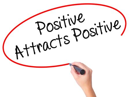 positiveness: Women Hand writing Positive Attracts Positive with black marker on visual screen. Isolated on white. Business, technology, internet concept. Stock Photo