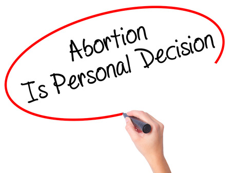 abortion womb: Women Hand writing Abortion Is Personal Decision with black marker on visual screen. Isolated on white. Business, technology, internet concept. Stock Photo Stock Photo