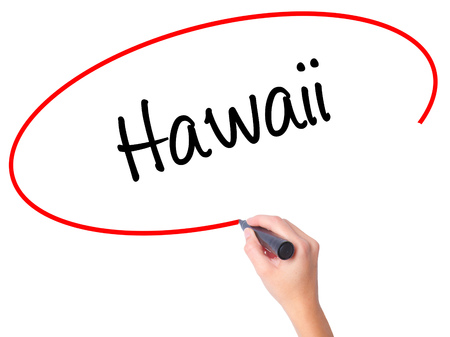 Women Hand writing Hawaii  with black marker on visual screen. Isolated on white. Business, technology, internet concept. Stock Photo