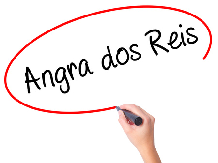 accommodating: Women Hand writing Angra dos Reis with black marker on visual screen. Isolated on white. Business, technology, internet concept. Stock Photo