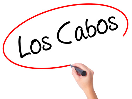 Women Hand writing Los Cabos with black marker on visual screen. Isolated on white. Business, technology, internet concept. Stock Photo