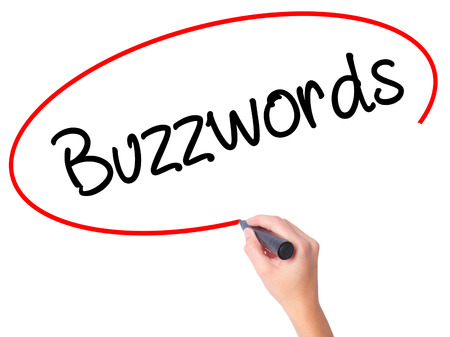 Women Hand writing Buzzwords with black marker on visual screen. Isolated on white. Business, technology, internet concept. Stock Photo Stock Photo
