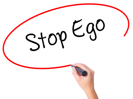 Women Hand writing  Stop Ego with black marker on visual screen. Isolated on white. Business, technology, internet concept. Stock Photo Stock Photo